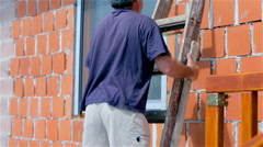 Placing ladder in front of window Stock Footage