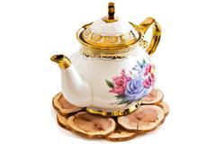 Ceramic teapot on wooden stand . Stock Photos