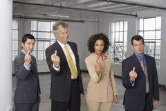 Group Portrait of Business People Making Rude Hand Gesture Stock Photos