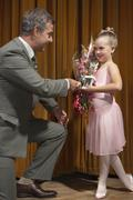 Ballerina Accepting Trophy - stock photo