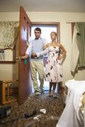 Couple Entering Messy Motel Room Stock Photos