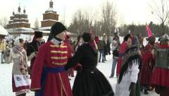 People in traditional Ukrainian costumes dance during folk festival Maslenitsa. Stock Footage