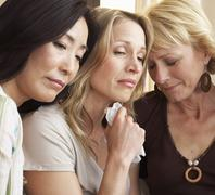 Friends Grieving Together - stock photo