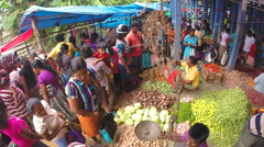Stock Video Footage of View of busy and crowded Sunday market with fresh produce.