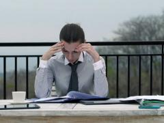 Overwhelmed, sad businesswoman with to much paperwork on terrace NTSC Stock Footage