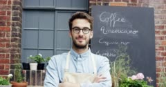 Happy barista man portrait outside cafe Stock Footage
