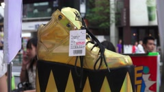 Crazy Gold Platfrom Shoe At Fashion Store Harajuku Tokyo 4K - stock footage