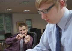 Employees Goofing Around - stock photo