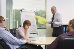 Manager and Staff in Meeting Stock Photos