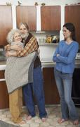 Mature Family in Kitchen Stock Photos