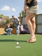 Woman Golfing - stock photo