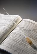 Orchestral Score with Baton - stock photo