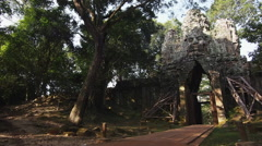 Cyclist Going Through Angkor Thom Gate, Siem Reap, Cambodia Stock Footage