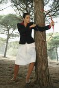 Businesswoman Using Bow and Arrow Stock Photos