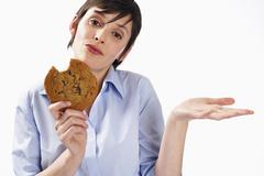 Woman Eating Cookie - stock photo