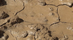 Desert. Dry ground, after flood, chopped by hot in summer heat. Drought season. Stock Footage