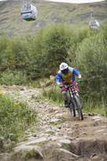Man Mountain Biking on Bike Path, Aonach Mor, Scotland Stock Photos