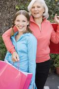 Grandmother and Granddaughter with Shopping Bags Stock Photos