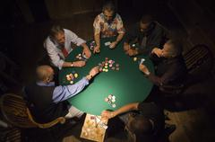 Men Playing Poker Stock Photos
