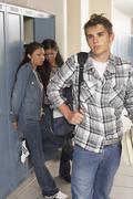 Girls Ogling Boy in School Hallway Stock Photos