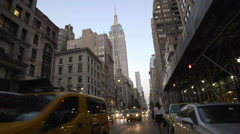 Empire State Building Manhattan New York City Lights NYC Traffic Hailing Taxi Stock Footage