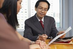 People Meeting with Financial Advisor Stock Photos