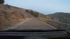 Twisting road down hill in the evening Stock Footage