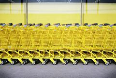 Row of Yellow Shopping Carts Stock Photos