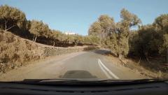 Bendy road driving amid olive groves - stock footage
