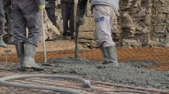 Concrete pouring works, compacting liquid cement - stock footage
