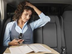 Businesswoman in Car Stock Photos