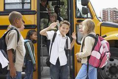 Children Boarding School Bus Stock Photos