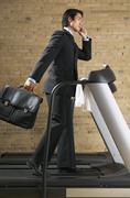 Businessman on Treadmill Stock Photos