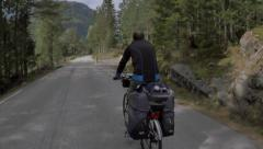Man in bicycle trip into the nature Stock Footage
