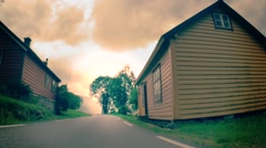 Path between wooden houses Stock Footage