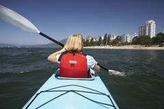 Woman Kayaking in False Creek, English Bay, Vancouver, British Columbia, Canada Stock Photos