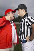 Coach Yelling at Referee Stock Photos