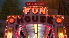A fun house at a carnival at night. - stock footage