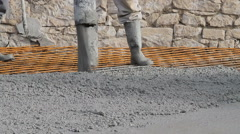 Concrete pouring works, compacting liquid cement Stock Footage