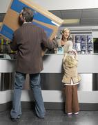 Father and Daughter Purchasing Television - stock photo