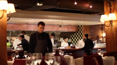 Staff working at chic sushi bar open kitchen Stock Footage