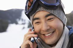 Man Using Cellular Phone on Ski Hill, Whistler, British Columbia, Canada Stock Photos