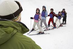 Man Teaching Students at Ski School, Whistler, British Columbia, Canada Stock Photos