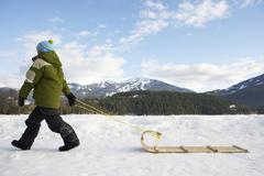 Boy Pulling Toboggan, Whistler, British Columbia, Canada Stock Photos