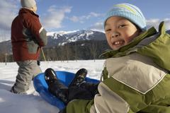 Father and Son Sledding, Whistler, British Columbia, Canada Stock Photos
