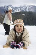 Woman Pulling Daughter on Toboggan, Whistler, British Columbia, Canada Stock Photos