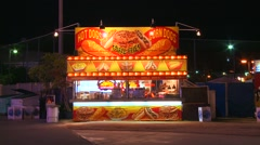 A lonely food stall at an amusement park, carnival or state fair at night. - stock footage