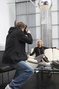 Photographer Taking Picture of Businesswoman - stock photo