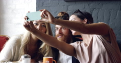 Friends taking selfie photograph self portrait in cafe Stock Footage