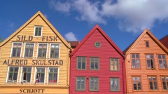 Stock Video Footage of Crooked and old colorful wooden buildings that line the streets of Bergen,